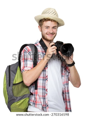 portrait of a young traveling man with backpack taking a picture isolated on white background - stock photo