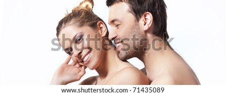 Portrait of a young undressed couple on white background