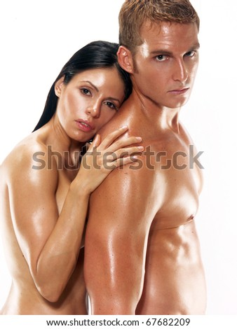 Portrait of a young undressed couple on white background. Portrait of a shaped and healthy young couple on white background.