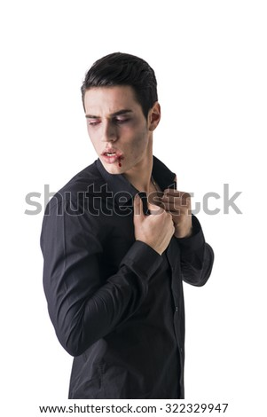 Portrait of a Young Vampire Man with Black T-Shirt, Looking at the Camera, Isolated on White Background.