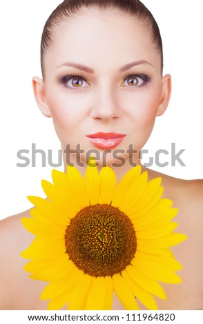 Portrait of a young well-groomed woman with sunflower isolated on white background - stock photo