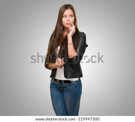 Portrait Of A Young Woman against a grey background - stock photo