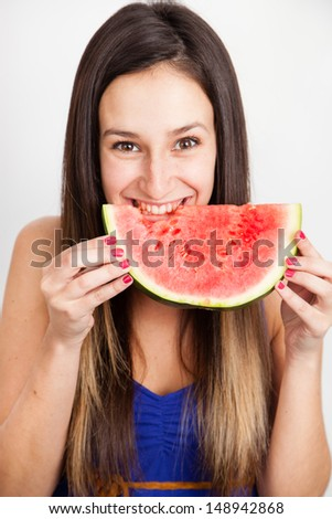 Portrait of a young  woman against a white background with water melon