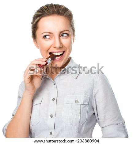 portrait of a young woman biting chocolate isolated on white background - stock photo