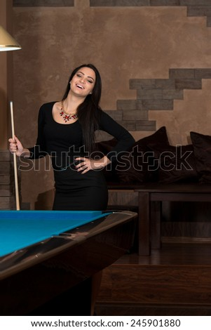 Portrait Of A Young Woman Concentration On Ball - stock photo