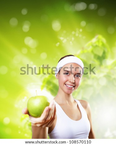Portrait of a young woman doing sport with a green apple - stock photo