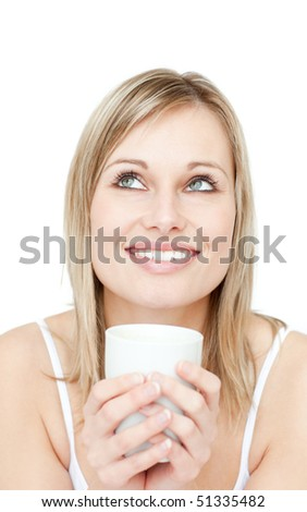 Portrait of a young woman drinking coffee against a white background - stock photo