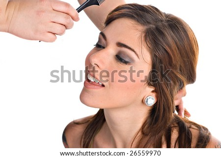 Portrait of a young woman getting her hair done - stock photo