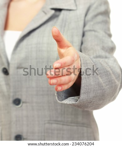 Portrait of a young woman giving her hand - stock photo