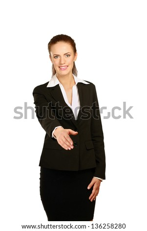 Portrait of a young woman giving her hand, isolated on white background