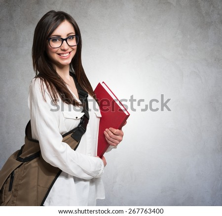 Portrait of a young woman holding a book - stock photo