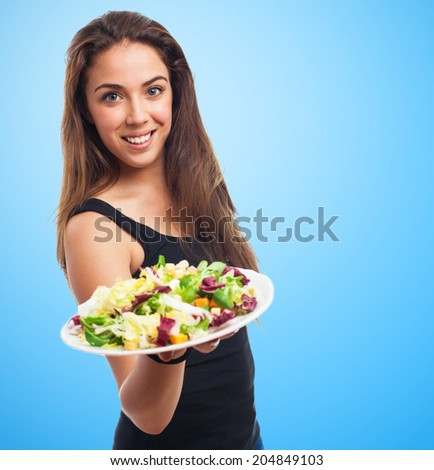 portrait of a young woman holding a fresh salad