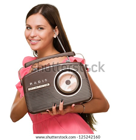 Portrait Of A Young Woman Holding Radio On White Background - stock photo