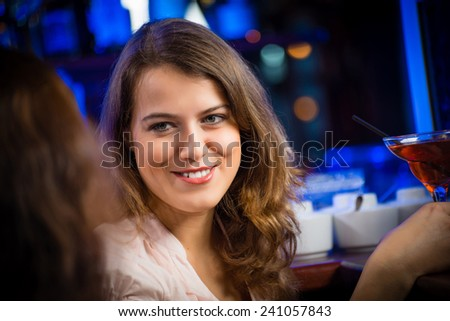 portrait of a young woman in a bar