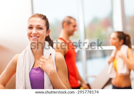 Portrait of a young woman in a fitness club - stock photo