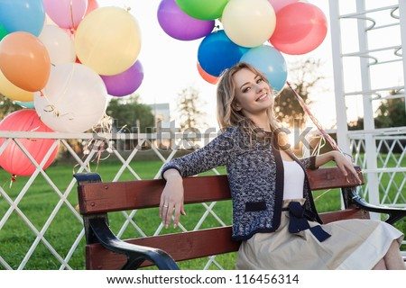 Portrait of a young woman in a park against the sunset, outdoors - stock photo