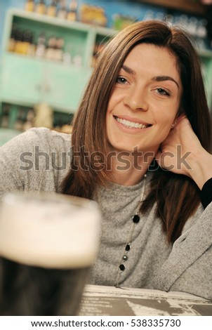 Portrait of a young woman in a pub