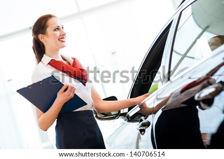 portrait of a young woman in a showroom consultant - stock photo