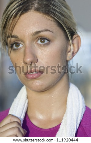 Portrait of a young woman in gym - stock photo