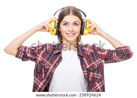 Portrait of a young woman in headphones, on a white background. - stock photo