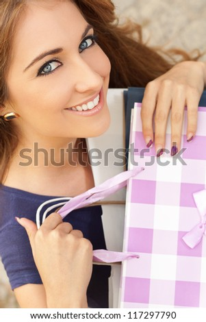 Portrait of a young woman in shopping - stock photo