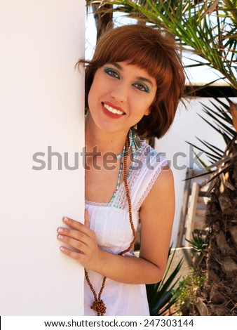 Portrait of a young woman in summer dress  - stock photo