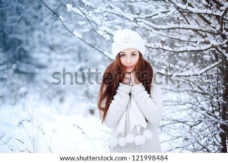 portrait of a young woman in winter park - stock photo