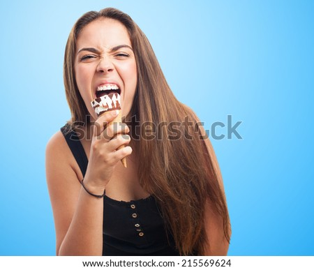 portrait of a young woman licking an ice cream