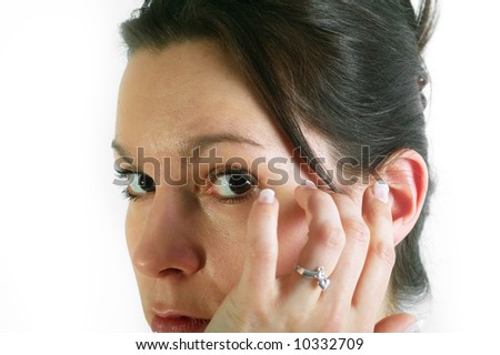 Portrait of a young woman, looking at the camera - stock photo