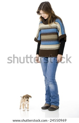 Portrait of a young woman looking to her cute puppy