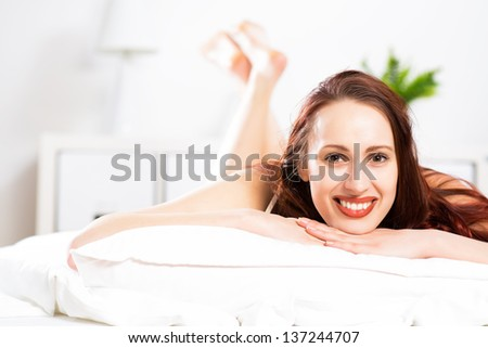 portrait of a young woman lying in the bedroom and rest