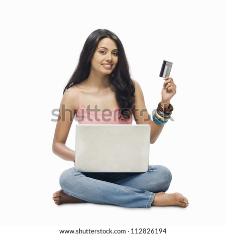 Portrait of a young woman online shopping - stock photo