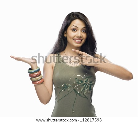 Portrait of a young woman pointing