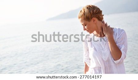 Portrait of a young woman relaxing on the beach