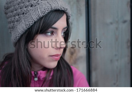 Portrait of a young woman's profile looking lonely - stock photo
