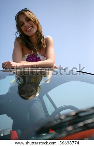 Portrait of a young woman smiling - stock photo