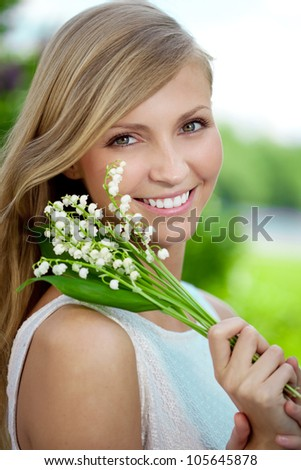 Portrait of a young woman smiling in a park, Outdoors - stock photo