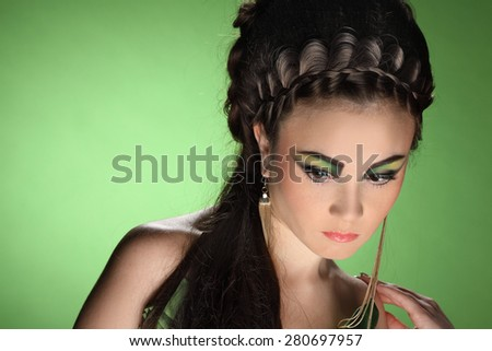 portrait of a young woman, stylish hairstyle, make-up art, studio photos, interesting image