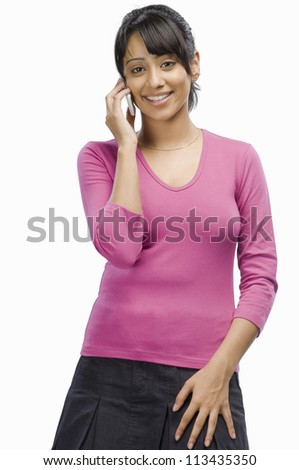 Portrait of a young woman talking on a mobile phone - stock photo