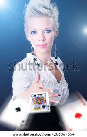 portrait of a young woman throwing poker cards - stock photo