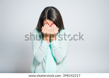 Portrait of a young woman tired closes eyes with her hands