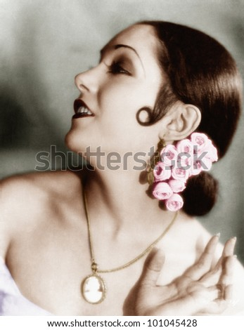 Portrait of a young woman wearing flowers in her hair - stock photo