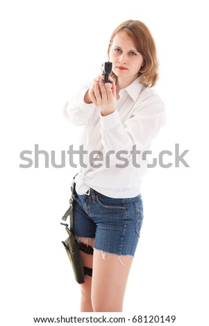 portrait of a young woman with a gun - stock photo