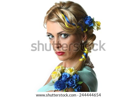 portrait of a young woman with a Ukrainian national symbols in hair. bouquet and ribbons of yellow and blue. beautiful makeup. fashionable hairstyle. emotional look. - stock photo