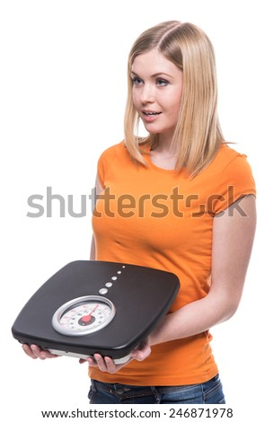 Portrait of a young woman with a weight in her hand. Concept of healthy lifestyle. - stock photo