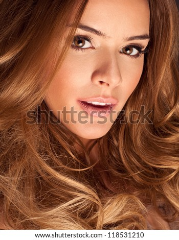 Portrait of a young woman with beautiful hair and eyes - stock photo