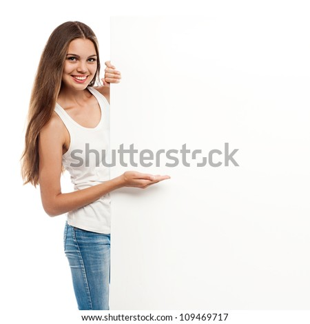 Portrait of a young woman with blank billboard isolated on white background