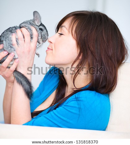 Portrait of a young woman with chinchilla - stock photo