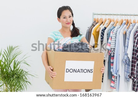 Portrait of a young woman with clothes donation