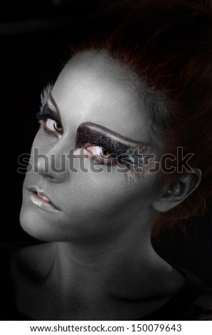 portrait of a young woman with fantasy makeup